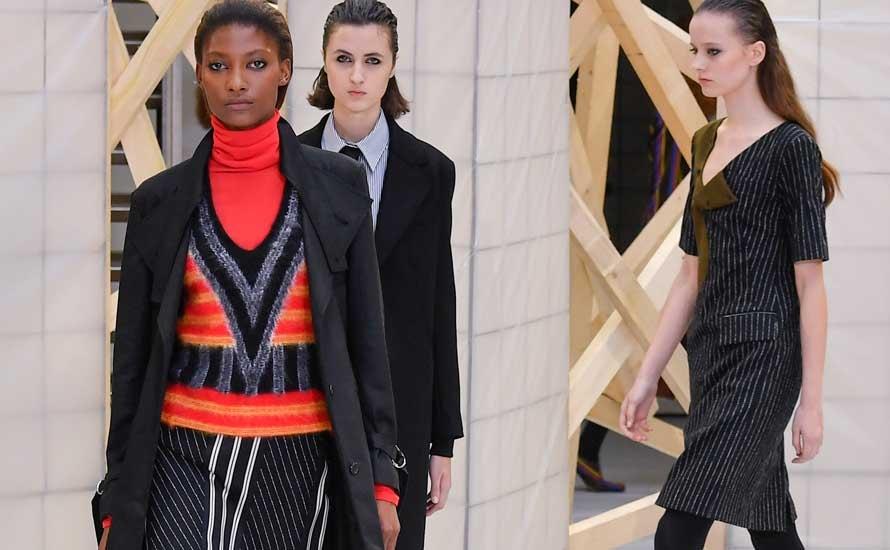 Women make grab for men's ties on Paris catwalk