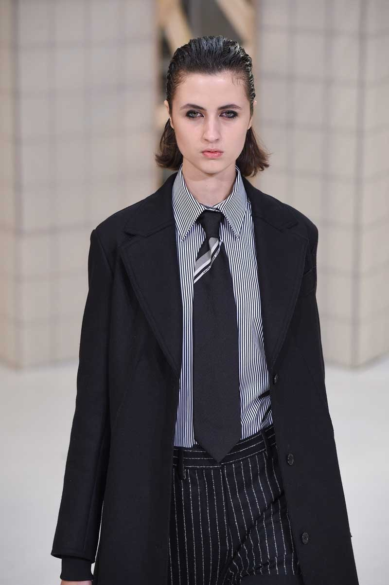 Women make grab for men's ties on Paris catwalk
